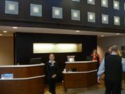 The front desk was replaced with smaller, individual check-in pedestals.