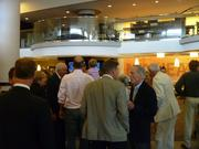 Guests mingle during Thursday's grand reopening.