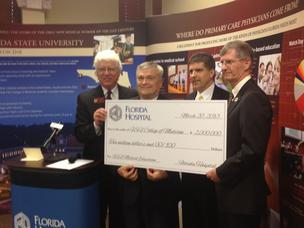 From left to right: Florida State University Orlando Regional Campus Dean Dr. Michael Muszynski, Florida State University President Eric J. Barron, Florida Hospital Executive Vice President Brian Paradis and College of Medicine Dean John P. Fogarty