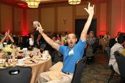 GTE Financial's Luis Gutierrez cheers when the company is announced as a finalist.