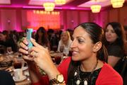 Michelle Hamilton, market affairs specialist with Florida Blue, takes a photo to tweet during the awards.
