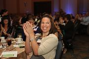 Julie Short cheers as Fowler White Boggs law firm wins in the 41-150 employees category.