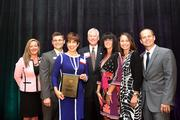 Fowler White Boggs law firm's Director of HR Deb Brewer, third from left, accepts the award for the company after being named the 2013 Healthiest Employer in Tampa Bay.