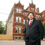 North Side boutique hotelier buys Mansions of Fifth