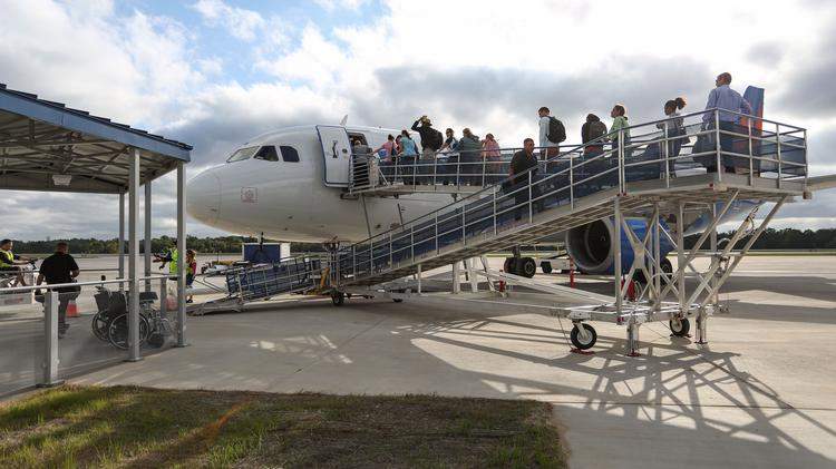 The first Allegiant flight to depart from the new Concord Regional Airport terminal boards on Wednesday morning for Orlando.