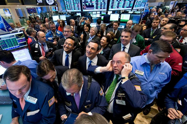 Model N Founder and CEO Zack Rinat watches from the trading floor of the New York Stock Exchange after raising more than $100 million in an IPO. The company's stock soared by more than 40 percent in its trading debut.