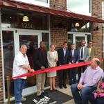 Ceremony marks completion of Revolution Mill's 1250 Building