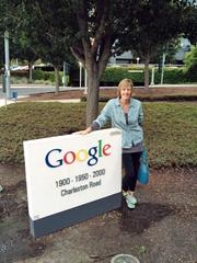 Rooibee Red Tea's Heather Howell is shown by a sign in front of Google Inc.'s headquarters in Mountain View, Calif.