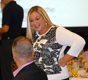 Professionals gathered Friday at the Cost of Reform forum hosted by the Sacramento Business Journal to hear a panel discuss impending changes to California's health care industry. Marcy McCulloch of Kaiser Permanente networks before the event.