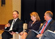 Professionals gathered Friday at the Cost of Reform forum hosted by the Sacramento Business Journal to hear a panel discuss impending changes to California's health care industry. Bruce Thomas, vice president of InterWest Insurance Services Inc, Carrie Owen Plietz, CEO of Sutter Medical Center and David Joyner, COO of Hill Physicians Medical Group speak at the panel.