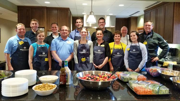 Physicians Realty Trust employees volunteer at the Ronald McDonald House in Wauwatosa.