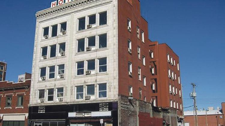 This 2013 file photo shows the vacant Midwest Hotel, a historic five-story structure at 1925 Main St., that will be preserved as part of the project.
