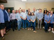 True Process employees all wore blue check shirts to work.