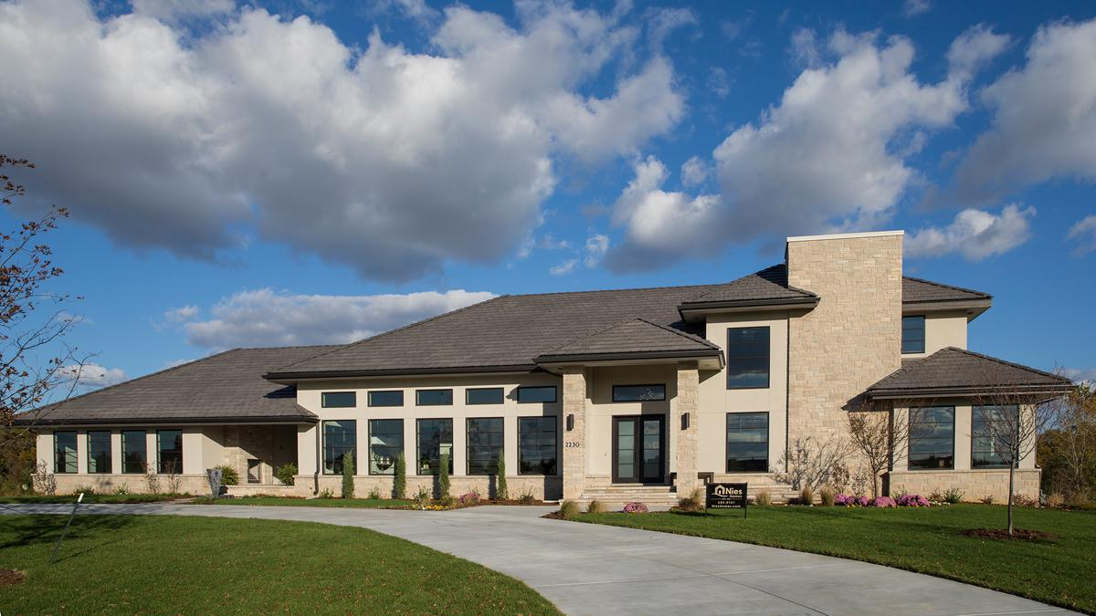 See inside nies homes 39 1 5m residence at flint hills for Spec home builders near me