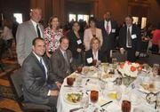 Honoree Cecelia Garber and the table from Marcum.