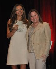 Honoree Liliana Paez of Global Smart Products and Melanie Dickinson.