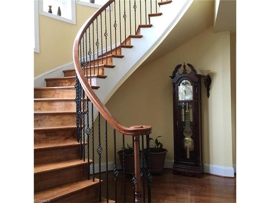 Prestigious living and entertaining awaits in this custom for 2 story spiral staircase