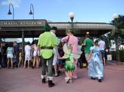 Peter, Tinkerbell and Wendy are among the first costumed guests to descend on the Magic Kingdom.
