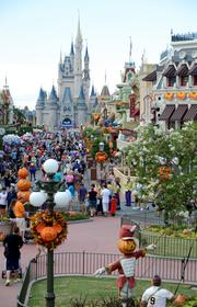 Main Street USA assumes all the colors of autumn, along with some jack o' lanterns and scarecrows.