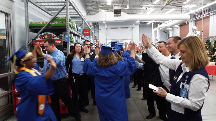 The first class of graduates from Wal-Mart's first training academy in  Illinois celebrated this