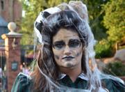 Cast members at the Haunted Mansion especially enjoy this time of year. She's having a blast, really.
