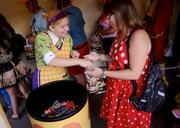 Guests of all ages get their sugar fix at many trick-or-treat stations around Magic Kingdom.