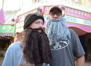 Zackary and Buddy McCullough of Balm, Fla., dressed as Jase and Si Robertson of A&E's Duck Dynasty. Not a Disney franchise!