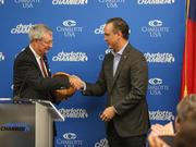 Commerce Secretary John Skvarla, III presents Doug Lebda, Lending Tree founder and CEO, with a congratulatory bowl as the company announced its plan to double in size and invest in Charlotte.
