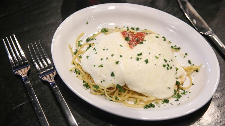 Chicken Parmesan is among the simple Italian dishes on the menu at Tavolo.