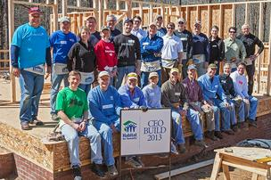 CEOs pose of the 2013 edition of Habitat for Humanity CEO Build program