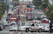 Police and firefighters respond to the report of a shooting at the Navy Yard in the District.