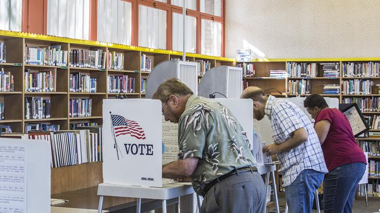 The library at Del Mar High School was converted for the day into a voting precinct