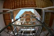 Temporary shoring holds up the historic roof of the brewhouse while walls are built underneath it.