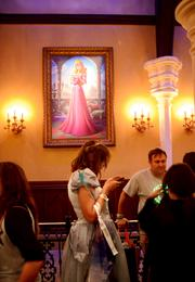 Princess Rapunzel on the wall, Princess Blackberry on the phone.