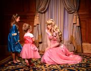 Princess Aurora holds court with some subjects. The popularity of the princess image is instantly identifiable with Disney.