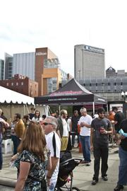 The festival took place in the shadow of downtown, down the road from the new Hilton hotel.