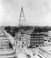 A vintage overview of downtown San Jose. In the top middle of the frame, a light tower serves as a focal point.