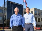 SelectQuote Insurance Services President Tom Grant (left) and COO Bill Grant will leave the company's Leawood headquarters, pictured here, larger, cooler space at Overland Park Xchange.