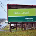 After KeyBank acquisition, banks are using ads, offices, cash to lure customers