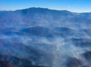 Smoke rises from the Great Smoky Mountains in Sevier County.