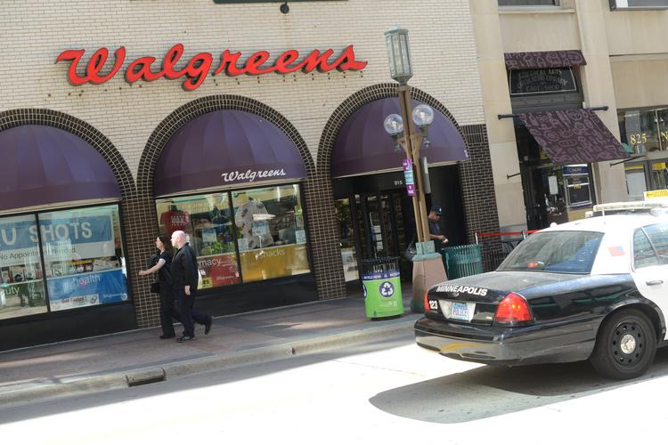 Police briefly closed Nicollet Avenue after a bomb threat to the downtown Minneapolis Walgreens store.