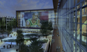 In the newest design, videos could be shown at night on the wall of the arena's team training facility. The facility is planned for the arena's main entry at First Avenue South and South Massachusetts Street. Deciduous trees and sheets of water would be on the plaza.
