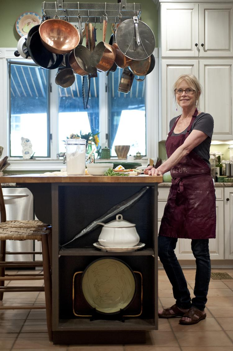Kathy Cary, shown here in her kitchen, will compete with 19 other chefs from kitchen across the United States for Best Chef in the Southeast at the James Beard Foundation awards.