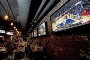 Fans watch games on the screens behind the bar at Troll Bar.
