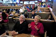 Donna Piercy reacts to a play by the U of L Cardinals during the Villanova game she and Glenn Pitchford were watching at Buffalo Wild Wings in St. Matthews.