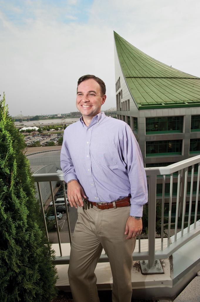 Mike Sewell is shown on a balcony at the Fleur de Lis Condominiums at East Main Street.