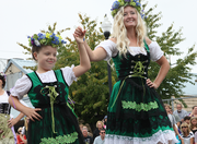 A mother-daugher dance takes place at the 2013 Mt. Angel Oktoberfest.