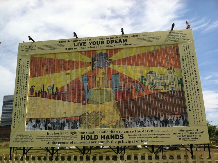This mural was put together with tiles made by visitors during Empowerment Week and sponsored by CSX. It is displayed at Railroad Park.