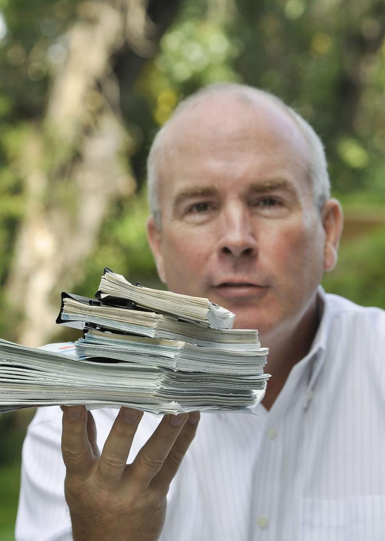 John Harpole, president of Mercator Energy LLC, a natural gas marketing and research company in Littleton, with 35 years of utility bills his mother kept in a box.