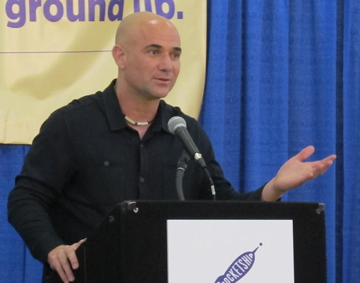 Tennis star Andre Agassi speaks at the school's opening Monday.